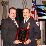 Mayor Marc N. Schrieks presenting plaque to Chief Matt Lombardi