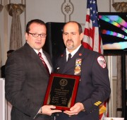 Mayor Marc N. Schrieks presenting plaque to Chief Matt Lombardi